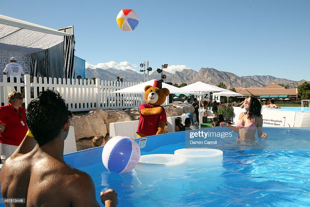 A general view of fans in the pool overlooking the 18th hole during the final round of the Shriners Hospitals For Children Open at TPC Summerlin on...