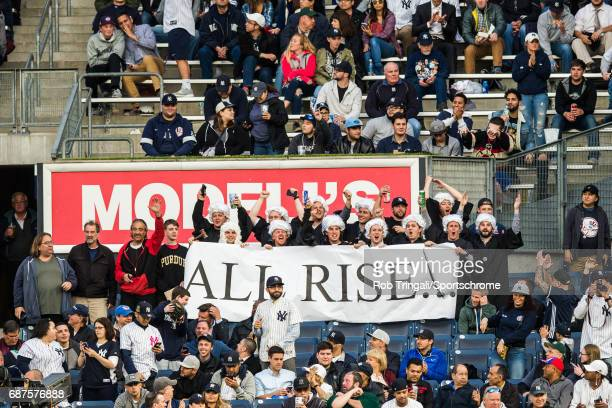 A general view of fans in the right field bleachers holding up an All Rise sign directed at Aaron Judge of the New York Yankees during the game...