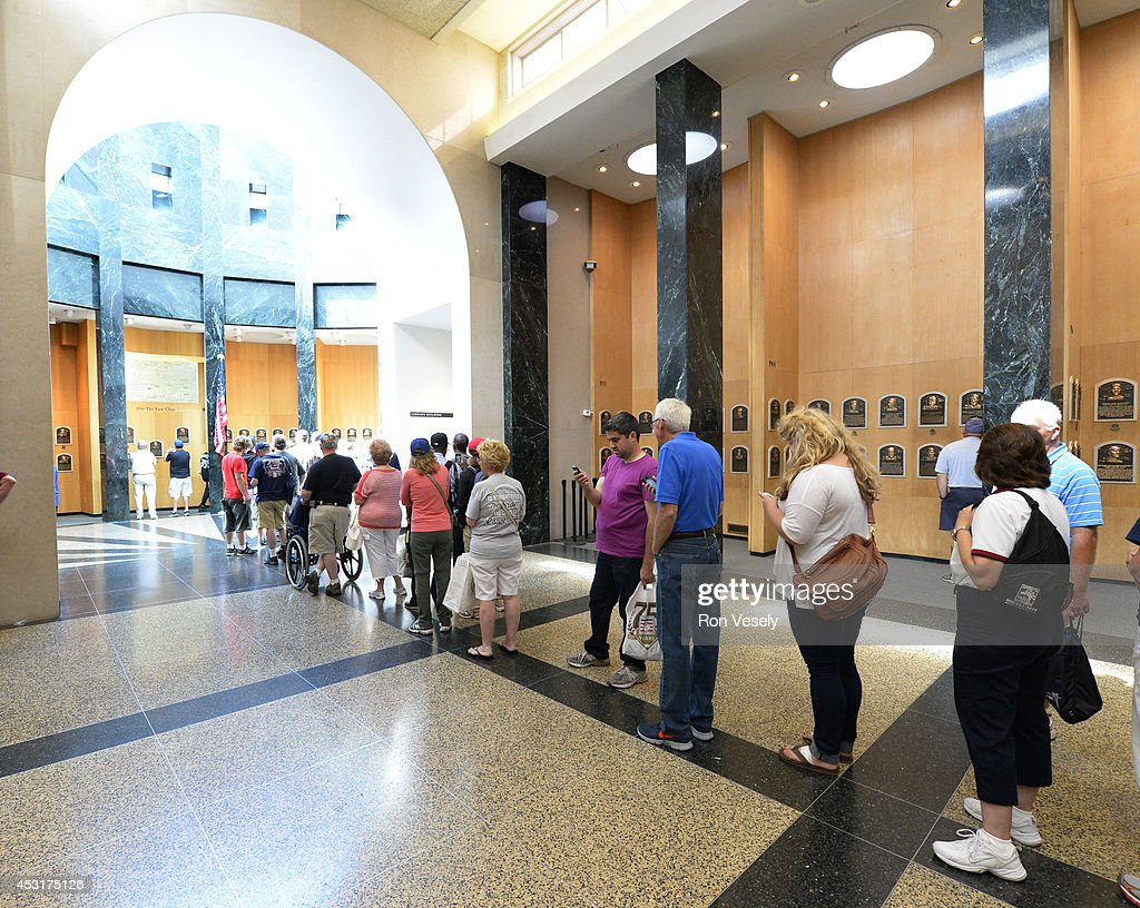 A general view of fans lined up to view the freshly installed HOF plaques featuring the 2014 Hall of Fame inductees on display at the Baseball Hall...