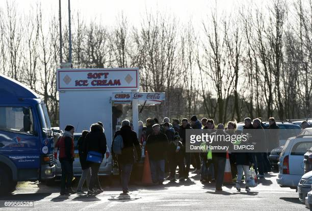 A general view of fans near an Ice Cream vendor outside the ground