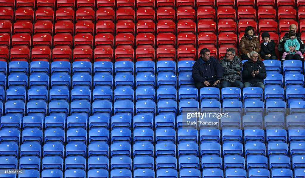 General View of fans sitting amongst rows of empty seats during the FA Cup with Budweiser Third Round match between Bolton Wanderers and Sunderland at the Reebok Stadium on January 5, 2013 in Bolton, England.