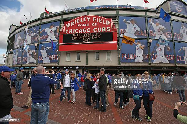 General view of fans take pictures outside the main entrance to Wrigley Field before the Opening Day game between the Chicago Cubs and the Milwaukee...