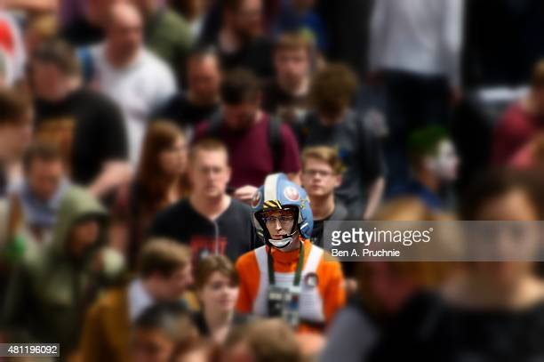 THIS IMAGE HAS BEEN PROCESSED USING DIGITAL FILTERS A general view of fans visiting the London Film and Comic Con at Olympia Exhibition Centre on...
