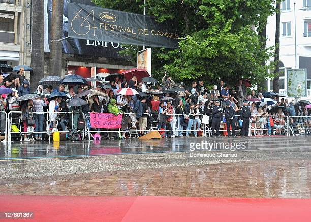 A general view of fans waiting in the rain ahead of the 'Pirates of the Caribbean On Stranger Tides' Premiere during the 64th Annual Cannes Film...