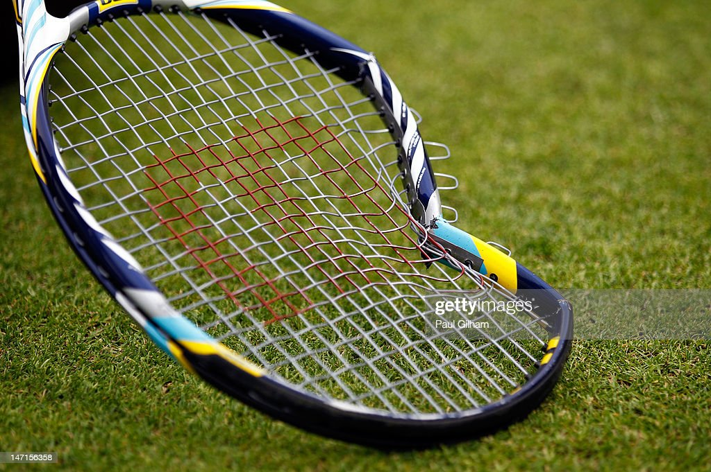A general view of Feliciano Lopez's broken tennis racket after losing his Gentlemen's Singles first round match against Jarkko Nieminen of Finland on day two of the Wimbledon Lawn Tennis Championships at the All England Lawn Tennis and Croquet Club on June 26, 2012 in London, England.
