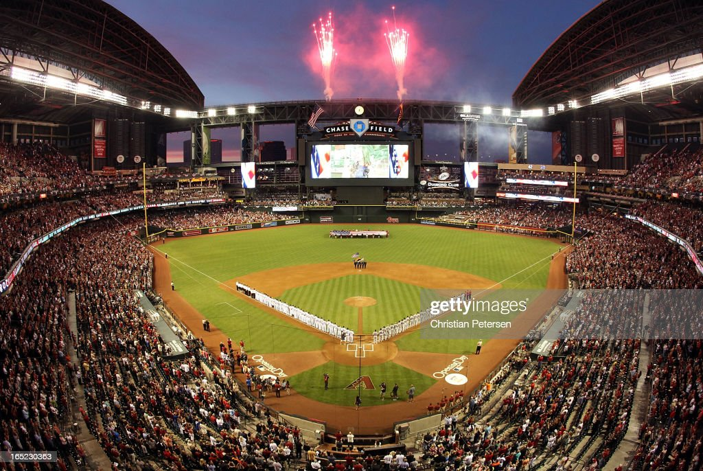 General view of fireworks exploding as the St. Louis Cardinals and the Arizona Diamondbacks stand attended for the National Anthem before the MLB Opening Day game at Chase Field on April 1, 2013 in Phoenix, Arizona.