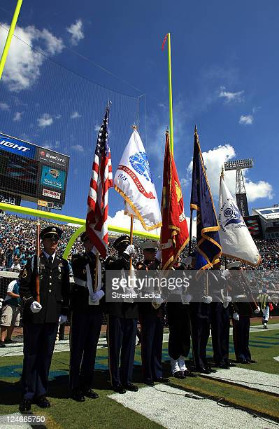 A general view of flag bearers remembering the 9/11 attacks ahead of the Tennessee Titans versus Jacksonville Jaguars during their season opener at...