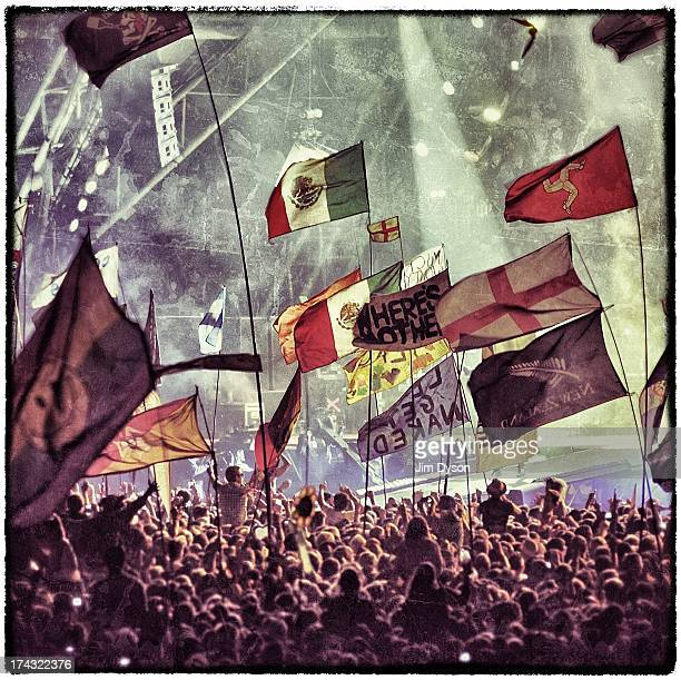 A general view of flags in the crowd as the Rolling Stones perform on the Pyramid stage during day 3 of the 2013 Glastonbury Festival at Worthy Farm...