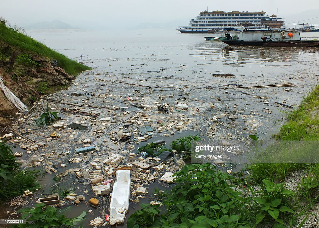 A general view of floating garbage on Yangtze River in the upper reaches of Three Gorges Dam on July 15, 2013 in Yichang, Hubei Province of China. Every year seasonal flooding causes a large build up of garbage in the Yangtze River, which is cleared up by garbage collectors who are often fisherman looking to earn an extra income.