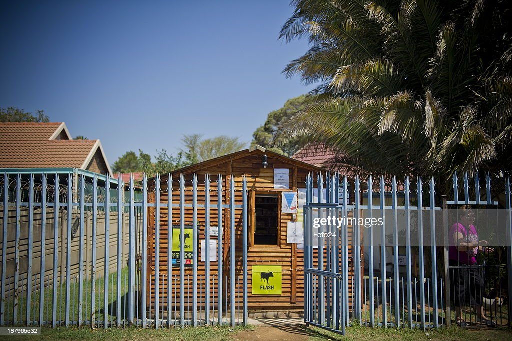 A general view of Florence van Niekerks spaza shop on November 12, 2013 in Kempton Park, South Africa. Van Niekerk started a small spaza shop in her backyard after she lost her job at a pharmacy. She sells airtime, bread, sweets and cigarettes and also takes customers blood pressure; tests for sugar and administers B12 injections. She is the only white person who recently completed a program for spaza shop owners presented by Wits Business School and Grand-Pa. A spaza shop is an informal convenience shop business in South Africa, usually run from home.