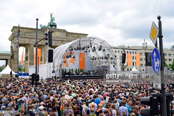General view of former President of the United States of America Barack Obama and German chancellor Angela Merkel at Brandenburg Gate during the...