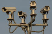 A general view of four CCTV surveillance cameras covering a car park near to the O2 Arena on March 18 2009 in London Government funding for CCTV...