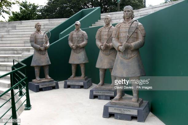 General view of four statues of Richard Gasquet Andy Roddick Nikolay Davydenko and Rafael Nadal dressed as Terracotta Warriors at Wimbledon