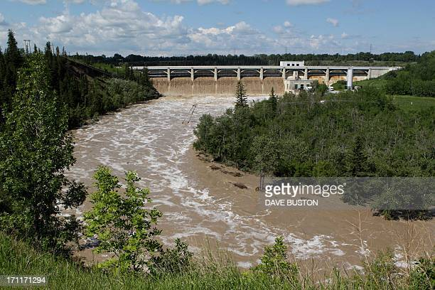 A general view of Glenmore Dam release water on the flooded Elbow River in Calgary Alberta Canada June 22 2013 AFP PHOTO/DAVE BUSTON