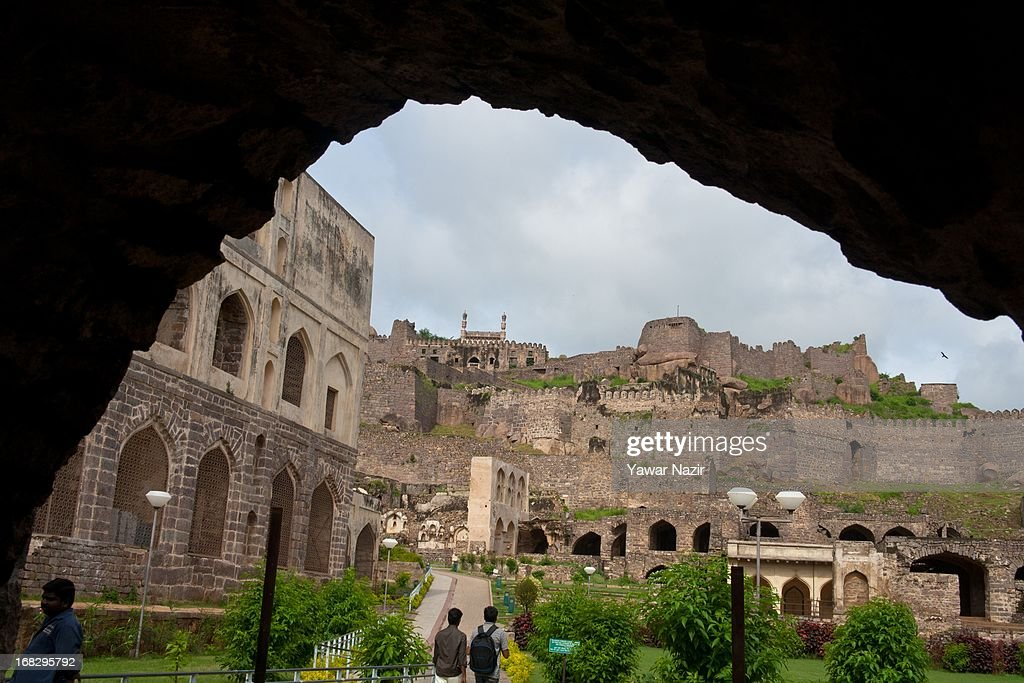 General view of Golkonda Fort in Hyderabad on May 8, 2013 in Hyderabad, India. The Golkonda fort is one of India's renowned citadels, situated in Hyderabad, the capital of Andhra Pradesh state. According to most Indian historians, a mud fort was built in the 13th century by the Kakatiya dynasty after the ruling king heard about a shepherd boy having come across an idol on a rocky hill known as Mangalavaram. Three centuries later, the fort came into the possession of the Qutub Shahi dynasty, who expanded it into a massive fort of granite, extending around 5 km in circumference, before Mughal emperor Aurangzeb conquered it in 1687. The present complex comprises four distinct forts with a 10 km long outer wall with 87 semicircular bastions (some still mounted with cannons), eight gateways and four drawbridges, with a number of royal apartments, halls, temples, mosques and stables inside. The Golkonda fort is said to have had a vault where the famous Kohinoor and Hope diamonds were stored along with other diamonds.