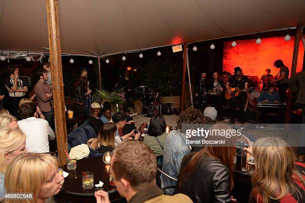 General view of guests attending the Marshall Headphones secret and intimate speakeasy popup party at the SXSW 2015 music festival in Austin Texas...