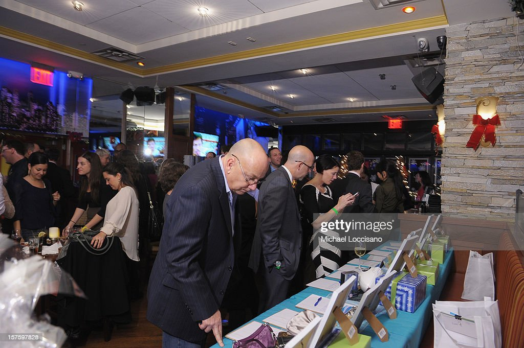 General view of guests looking at items in the silent auction during the Hearing Health Foundation's Junior Board Holiday Fundraiser at Ashton's Alley on December 4, 2012 in New York City.