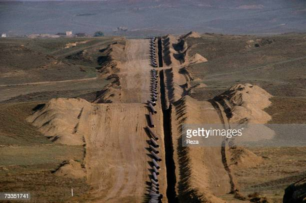 General View of hills where workers have dug a trench part of a massive project to build oil pipelines on September just outside the ancient city of...