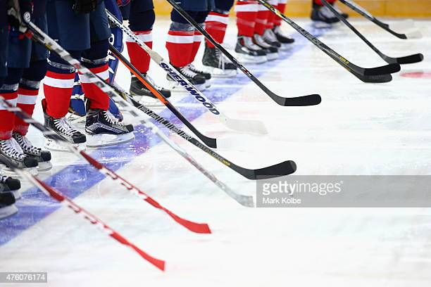A general view of hockey sticks on the ice is seen during the anthems ahead of the 2015 Ice Hockey Classic match between the Unites States and Canada...