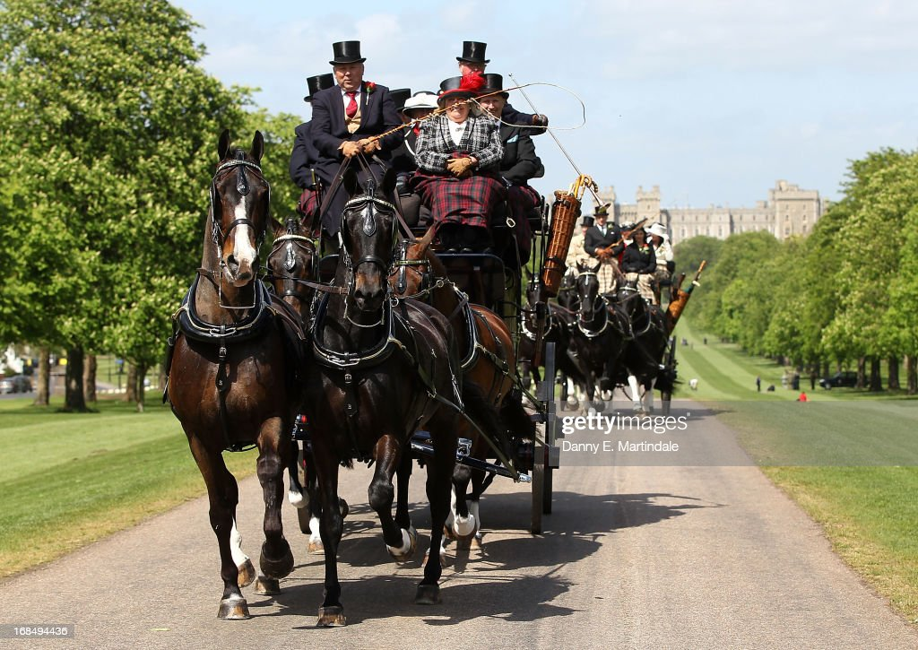 General view of horse drawn carriages driving down Queen Anna's Drive on day 3 of the Royal Windsor Horse Show on May 10, 2013 in Windsor, England.