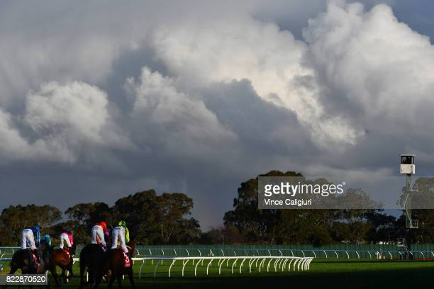 General view of horses and riders crossing the finish line in Race 8 during Melbourne Racing at Sandown Hillside on July 26 2017 in Melbourne...