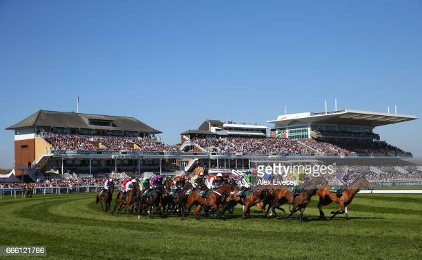 A general view of horses and riders taking the first bend is seen during the Gaskells Handicap Hurdle Race at Aintree Racecourse on April 8 2017 in...