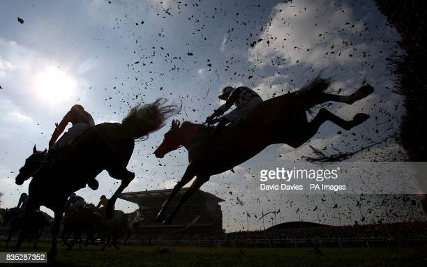 A general view of horses jumping a fence during the John Smith's Red Rum Handicap Chase