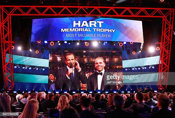 A general view of host Will Arnett and Hart Trophy nominee Patrick Kane projected on the big screen is seen during the 2016 NHL Awards at The Joint...