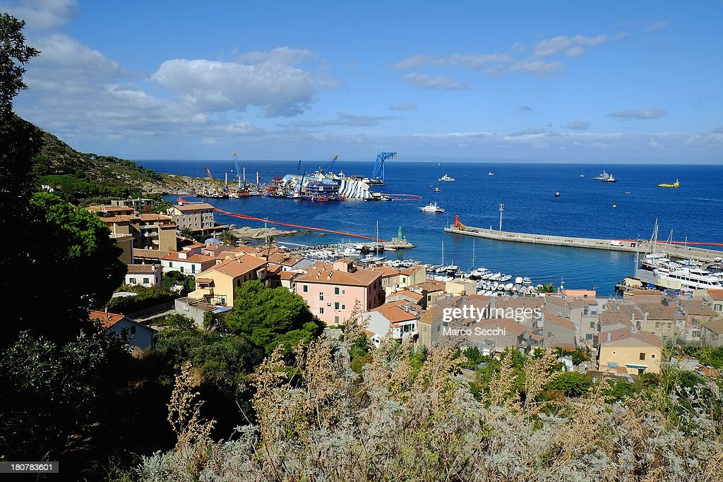 A general view of il Giglio as the parbuckling operation to raise the stricken Costa Concordia continues on September 16, 2013 in Isola del Giglio, Italy. Work begins today to right the stricken Costa Concordia vessel, which sank on January 12, 2012. If the operation is successful, it will then be towed away and scrapped. The procedure, known as parbuckling, has never been carried out on a vessel as large as Costa Concordia before.