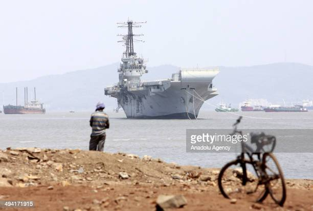 A general view of INS Vikrant an aircraft carrier near a ship breaking yard at Darukhana in Mumbai India on May 28 2014 Indian Navy sold INS Vikrant...