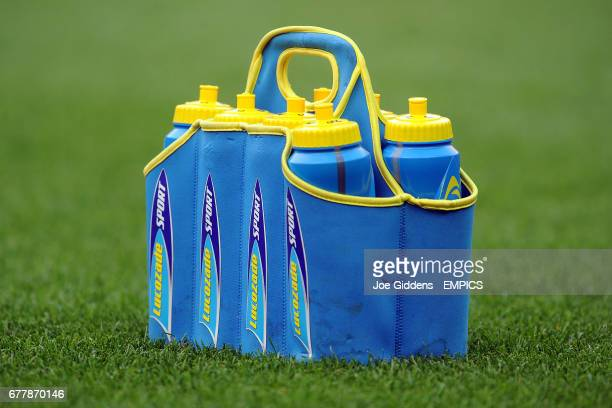 General view of Lucozade bottles and carrier on the pitch