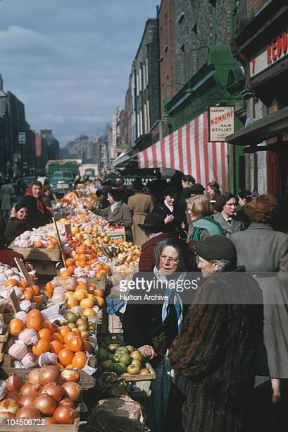 A general view of market stalls selling fruit and vegetables in Dublin Ireland circa 1950