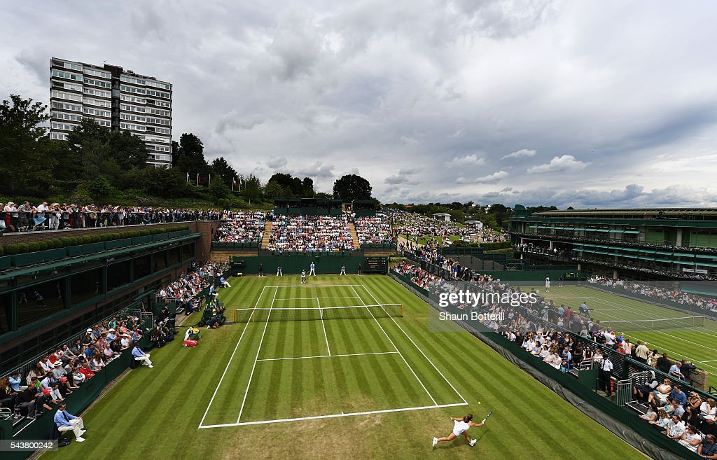 A general view of match action on court 18 as <a gi-track='captionPersonalityLinkClicked' href=/galleries/search?phrase=Venus+Williams&family=editorial&specificpeople=171981 ng-click='$event.stopPropagation()'>Venus Williams</a> of The United States faces <a gi-track='captionPersonalityLinkClicked' href=/galleries/search?phrase=Maria+Sakkari&family=editorial&specificpeople=15013420 ng-click='$event.stopPropagation()'>Maria Sakkari</a> of Greece in the Ladies Singles second round match on day four of the Wimbledon Lawn Tennis Championships at the All England Lawn Tennis and Croquet Club on June 30, 2016 in London, England.