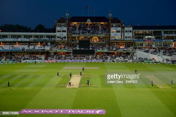 A general view of match action under floodlights at the Kia Oval