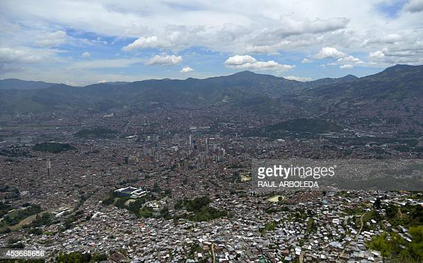 General view of Medellin with the Comuna 8 shantytown on the foreground in Antioquia department Colombia as seen on August 14 2014 More than 4000...