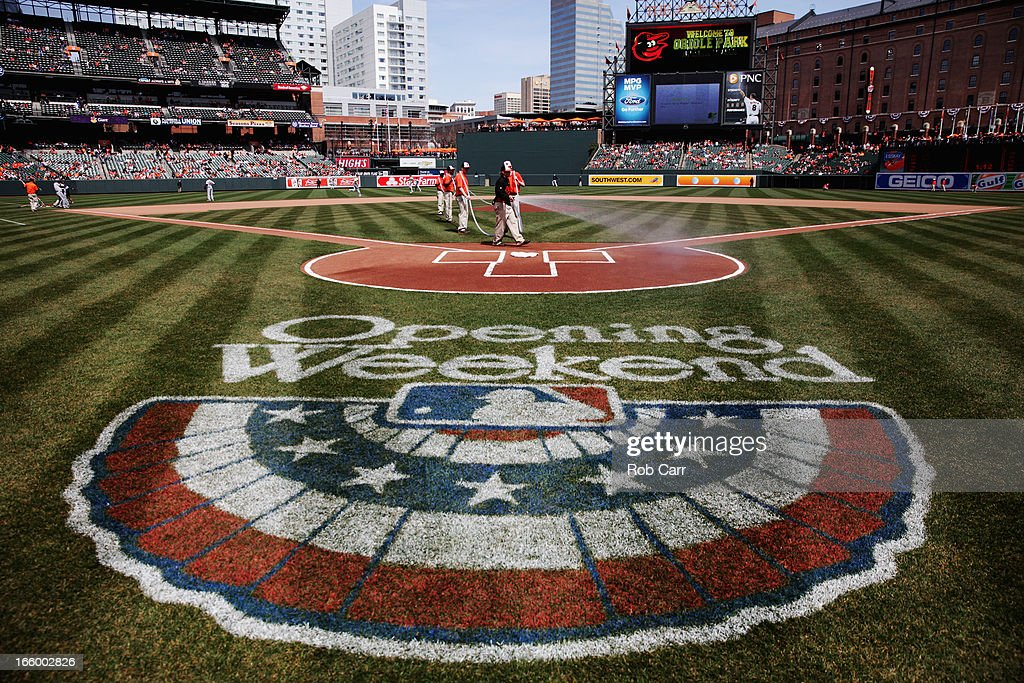 General view of members of the grounds crew groom the field before the start of the Baltimore Orioles and Minnesota Twins game at Oriole Park at Camden Yards on April 7, 2013 in Baltimore, Maryland.