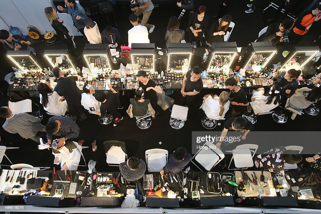 A general view of models make up preparing for the Michael Kors Jet Set Experience fashion show on May 9, 2014 in Shanghai, China.
