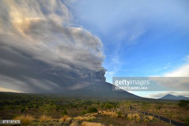TOPSHOT General view of Mount Agung during an eruption seen from Kubu subdistrict in Karangasem Regency on Indonesia's resort island of Bali on...