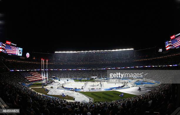 A general view of musician Kris Allen performing the national anthem before the start of the 2015 Coors Light NHL Stadium Series game between the Los...