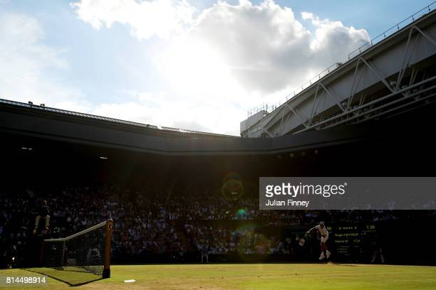A general view of of centre court as Roger Federer of Switzerland serves during the Gentlemen's Singles semi final match against Tomas Berdych of The...