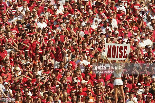 General view of Oklahoma Sooners fans filling the seats of the Cotton Bowl while a cheerleader holds up a sign during the game against the Texas...