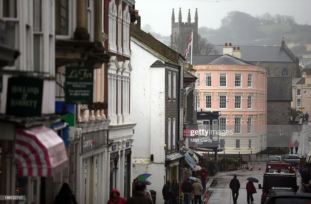 A general view of one of the main shopping streets of Totnes is seen on January 8, 2013 in Totnes, England. The Devon town is renowned for its belief in promoting trade of local independent retailers, famously denying the plans by national coffee chain Costa to open a high street branch in the town. Boasting its own local currency, Totnes has a shop vacancy rate of 6%, less than half than the national average, whilst 80% of outlets are independently owned.