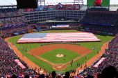 General view of opening day ceremonies before the start of the game between the Texas Rangers and the Los Angeles Angels of Anaheim at Rangers...