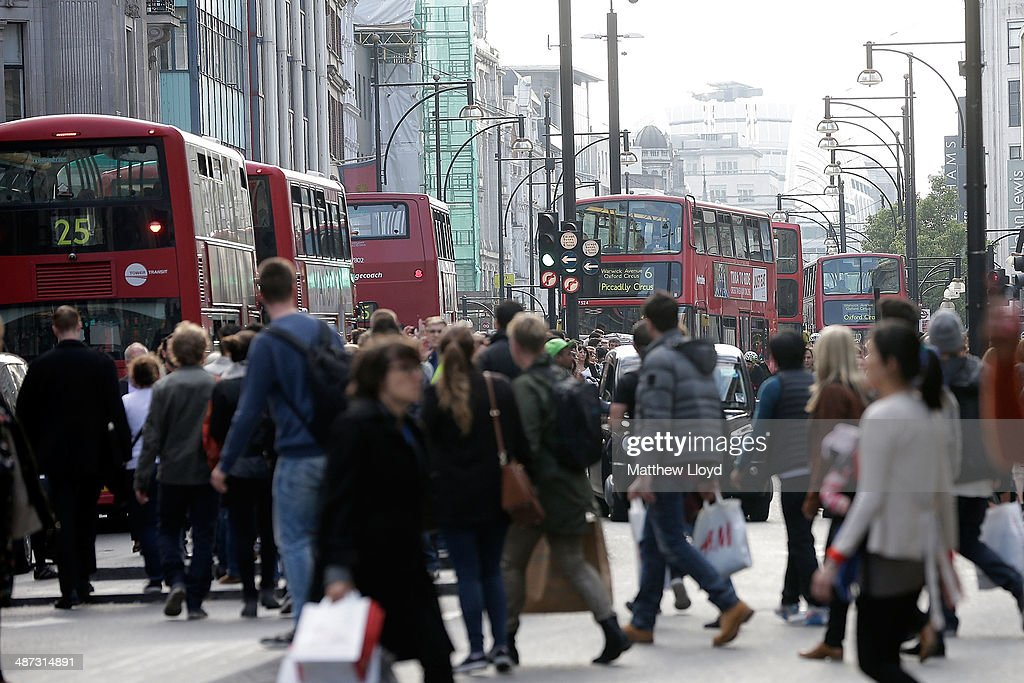 A general view of Oxford Street as commuters attempt to board buses whilst crowds flock to the area for the launch of the new Kate Moss range at...