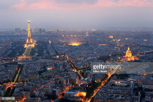 General view of Paris at dusk with the Eiffel Tower and the Hotel des Invalides prominent on June 10 2008 in Paris France