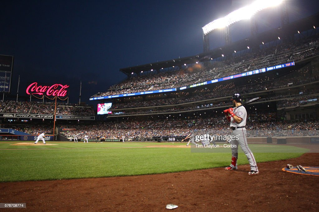 A general view of pitcher Bartolo Colon of the New York Mets pitching to Daniel Murphy of the Washington Nationals with Bryce Harper of the...