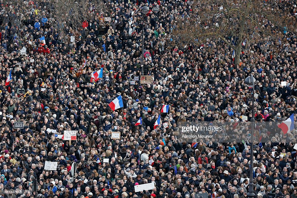 A general view of Place de la Nation during a mass unity rally following the recent terrorist attacks on January 11, 2015 in Paris, France. An estimated one million people have converged in central ParisÊ for the Unity March joining in solidarity with the 17 victims of this week's terrorist attacks in the country. French President Francois Hollande led the march and was joined by world leaders in a sign of unity. The terrorist atrocities started on Wednesday with the attack on the French satirical magazine Charlie Hebdo, killing 12, and ended on Friday with sieges at a printing company in Dammartin en Goele and a Kosher supermarket in Paris with four hostages and three suspects being killed. A fourth suspect, Hayat Boumeddiene, 26, escaped and is wanted in connection with the murder of a policewoman. Ê