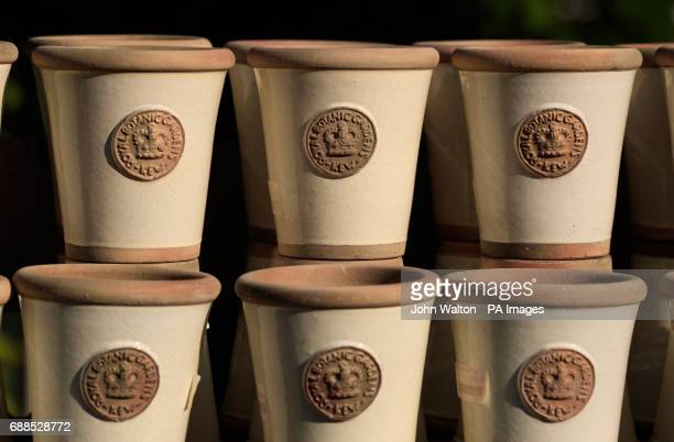 A general view of plant pots with Kew Gardens logos for sale at The Royal Botanic Gardens Kew London