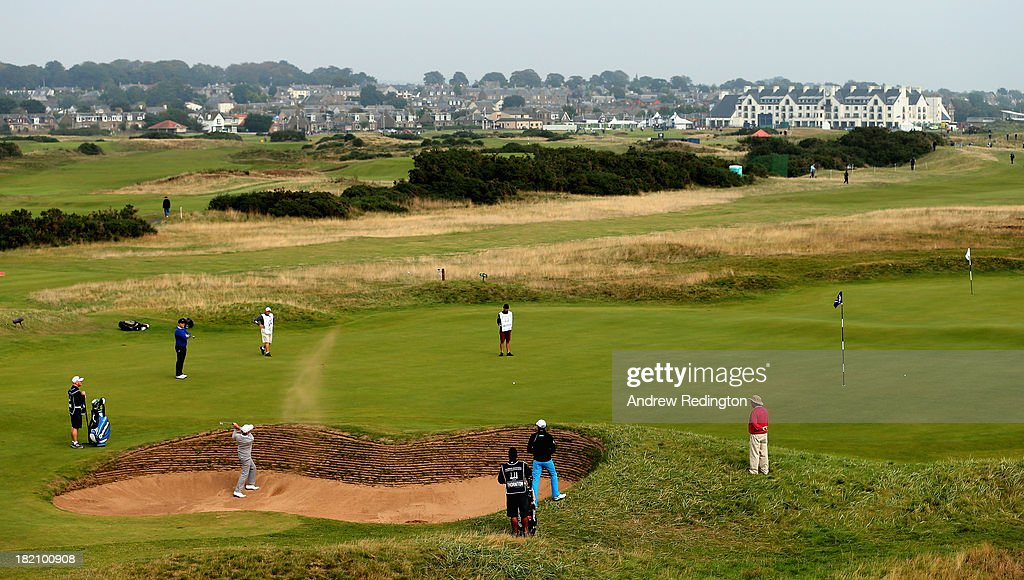 A general view of play as David Higgins of Ireland plays a biunker shot on the 14th hole during the third round of the Alfred Dunhill Links Championship at the Carnoustie Golf Links on September 28, 2013 in Carnoustie, Scotland.