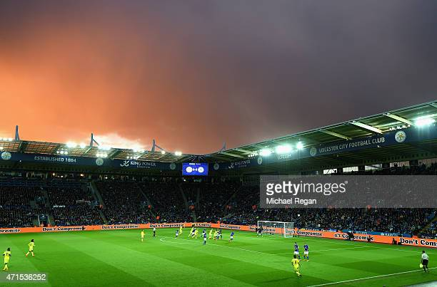 A general view of play as stormy skies are seen over the stadium during the Barclays Premier League match between Leicester City and Chelsea at The...